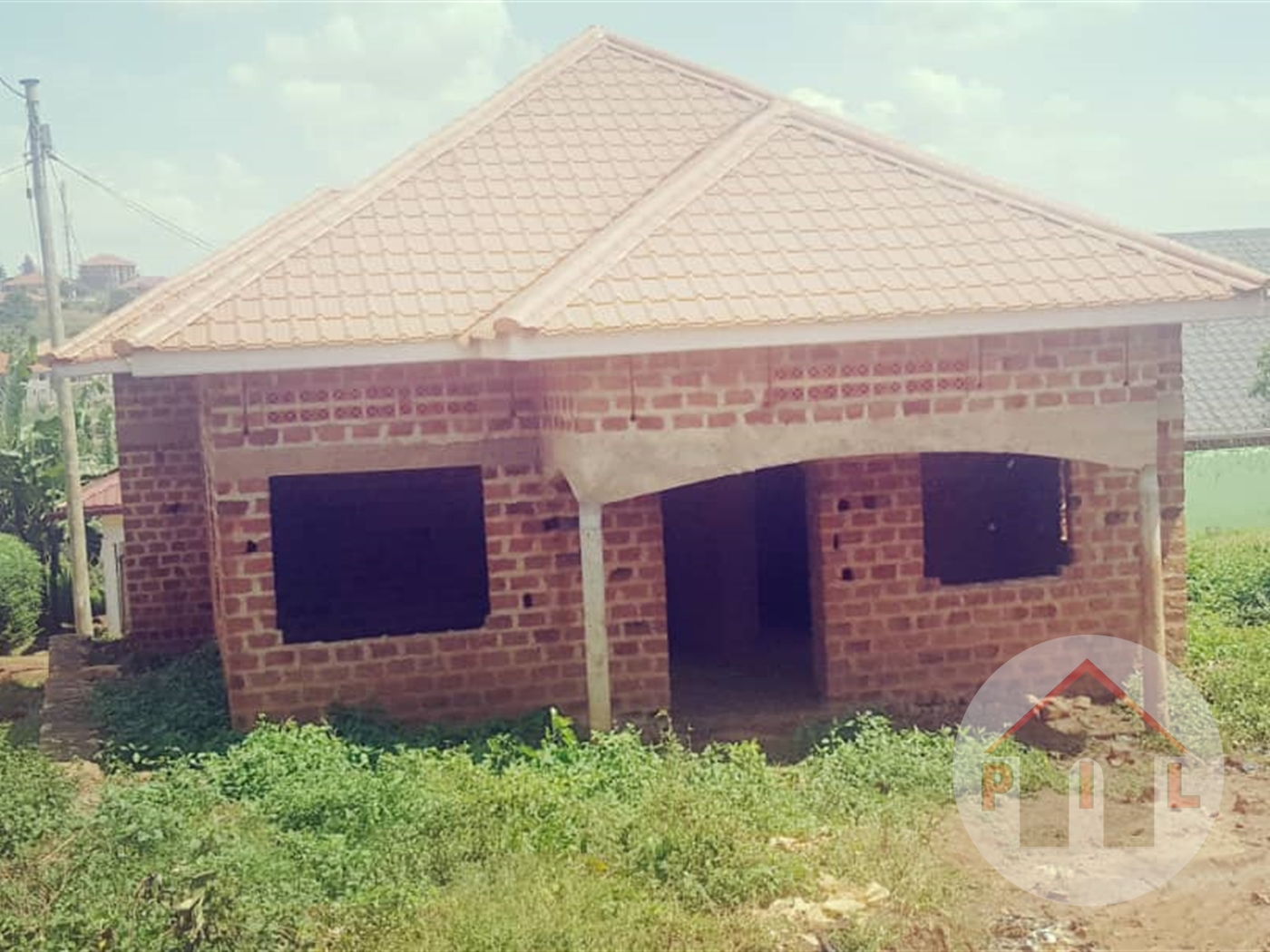 Shell house for sale in kira kampala front view main image